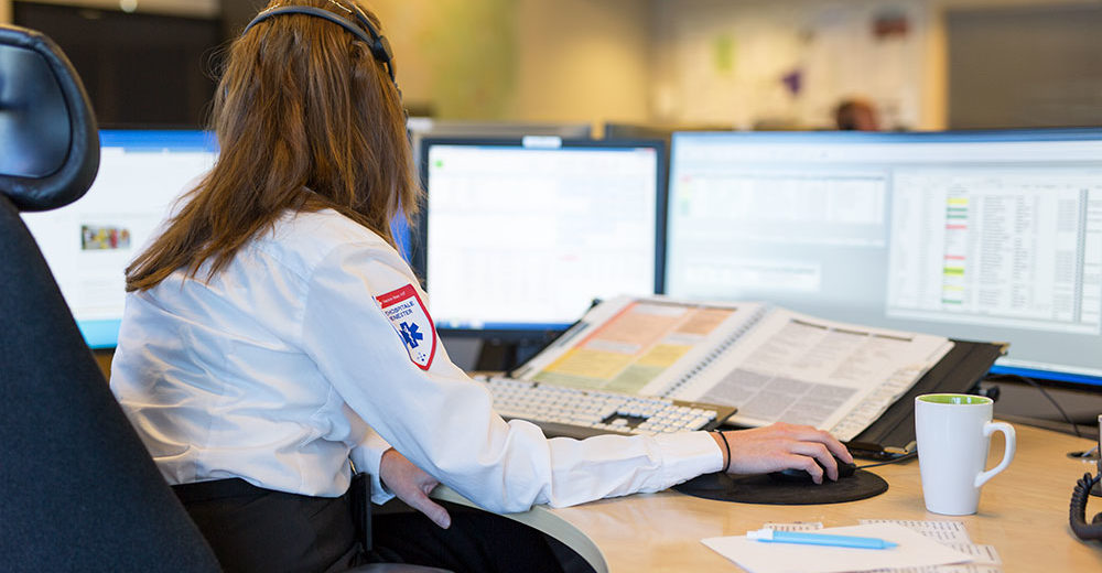 Woman working in Emergency Medical Communication Center.