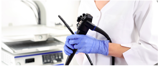 Doctor holding endoscopy probe.
